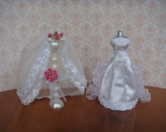 1/12th scale mannequin dressed in white satin wedding dress
