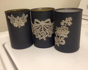 Painted tin cans with flower stickers