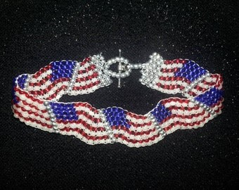 High Quality Glass Beads Patriotic / 4th of July American Flag Bracelet.  Can be made wavy or straight.
