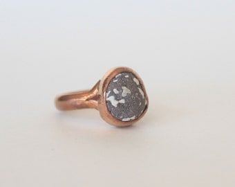 Gray basalt ring with copper band