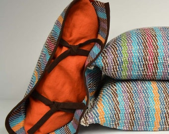 Handwoven cushion of linen. Weaving many-coloured and orange. One of a kind and original weaving.