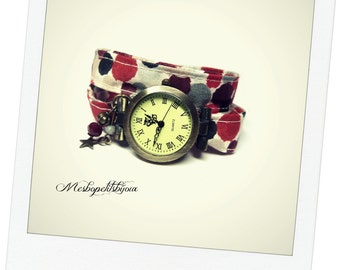 wristwatch in tissue red polka-dot, two towers