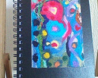 An A5 sketchpad with abstract needle felt cover