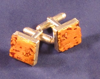 Upcycled wine cork set in sterling silver cufflinks.  1.4cm square