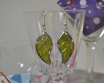 Earrings of glass and Tin. Green leaves