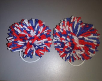 2 handmade, large, red, white and blue pom pom hair ties.