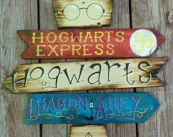 Harry Potter direction sign.  Medium size. Rustic weathered look.  Looks like it came from the world of Harry Potter itself.