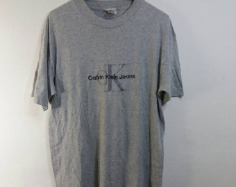 Vintage Calvin Klien Jeans tee/spellout/grey/medium/made in usa