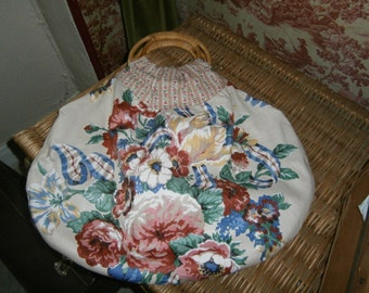 A one off Extra large ,inside out bag ,with cane handles , vintage fabric,wonderful crafters bag