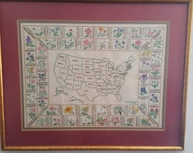 Hand stitched united states map with state flowers