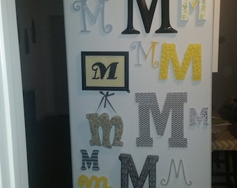 "Wooden Yellow and Gray ""M"" Letters"