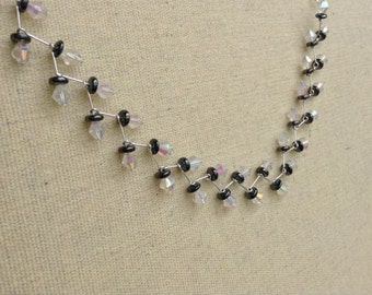 White and Black Leaf Crossed Necklace