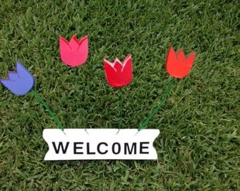 A  welcome sign for every household or flowers for those without a green thumb!