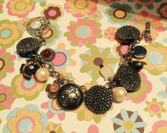 Button and charm bracelet