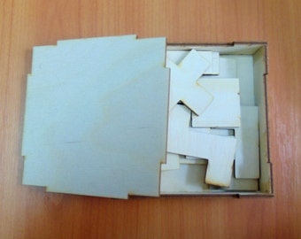 Pentomino puzzle in wood box