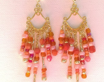 Coral colored gold chandelier earrings