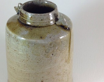 Small Wood fired soda glazed bottle.