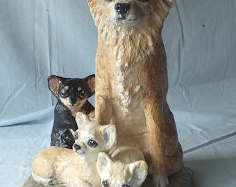 A Paper mache sculpture of a Longcoat Chihuahua sitting Mum and Pups
