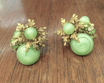 Vintage Miriam Haskell earrings with green glass stones 1950s designer signed.