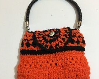 Handmade textured Orange Crochet purse with built in lighting and organizer.