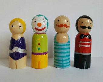 Circus set of wooden peg dolls, strong man, clown, trapeze girl and ringmaster pegdoll