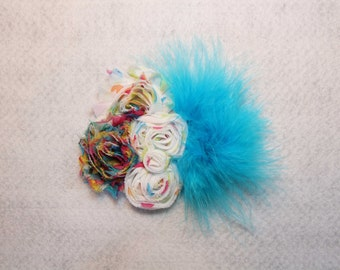 Multi-colored bow with teal feather