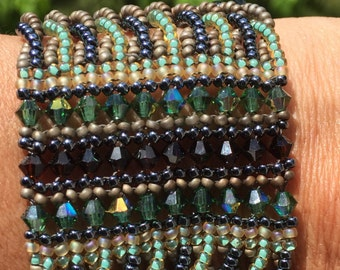 Beaded cuff bracelet with Swarovski crystals and vintage buttons