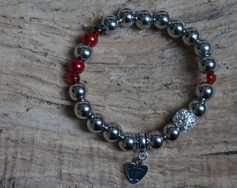 Pearl bracelet metallic with red beads 2172