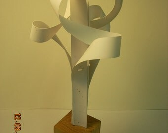 "A Free standing sculpture    ""  atoms in motion"".......... the test of times"