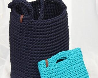 woman's dark blue shoulder bag