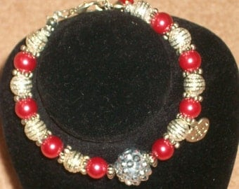 Red and silver bracelet with charm