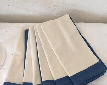 6 cream and blue cotton napkins.