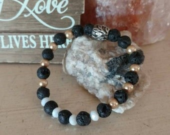 Beautiful volcanic rock and white glass rondel bracelet