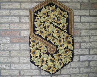 Table runner featuring sunflowers