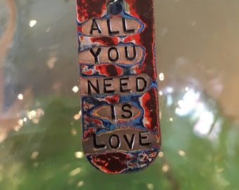 All You Need is Love, Dog Tag