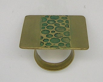 Serious turquoise brass ring