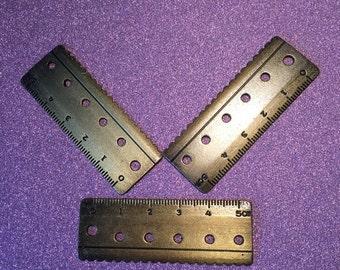 4 Antique Bronze Rulers