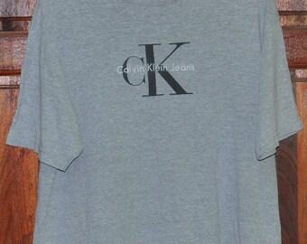 Vintage CK Calvin Klein Sport New York Jeans Couture 90's Big Logo Gray Hip Hop Rap Swag Tee T shirt Size L