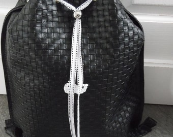 Black faux leather braided pool bag
