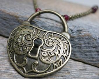Cupid and Venus necklace ... antiqued copper / heart lock escutcheon / garnet / ruby / raspberry chalcedony