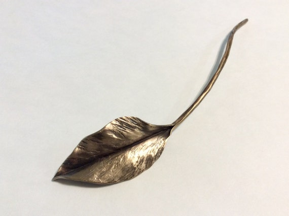 Bronze single leaf on a long stem, floral decor, forged,