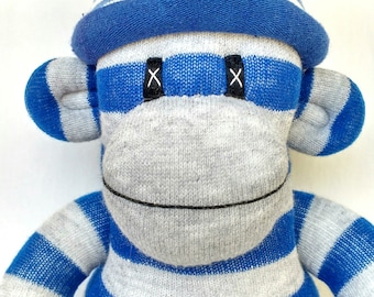 Blue and Grey Sock Monkey with pom pom hat. Harry Potter Hogwarts Ravenclaw mascot