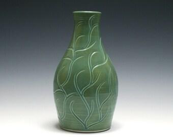 Green Vase with Carved Branch Design