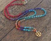 Bohemian Hand knotted silk beaded peace charm necklace. Colorful, vibrant, multi stone, dainty necklace.