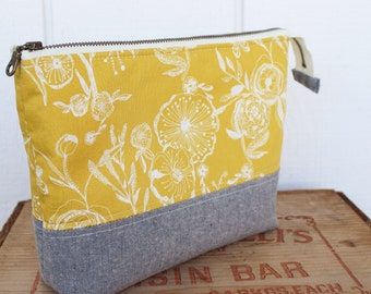 Open wide zippered pouch, gold wildflowers