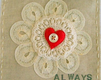 Small original textile art / applique. Vintage lace doily, neutral fabric, red heart, button, embroidery, text (Always)