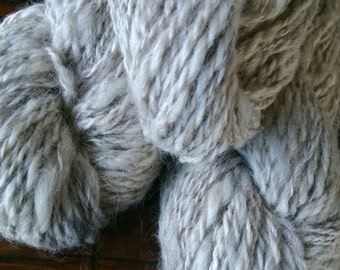 3 skeins of handspun Icelandic lamb and alpaca sweater yarn, natural cream and hint of brown colour
