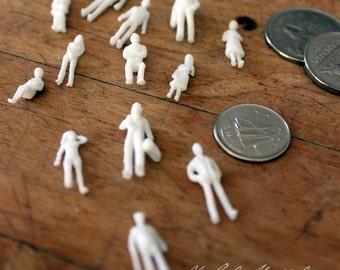 13 miniature human figures - white - 1:100 scale
