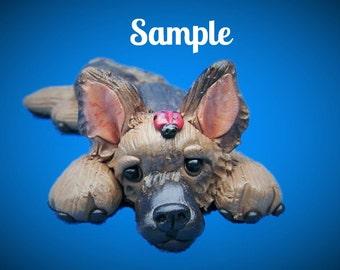Tan / Black German Shepherd Dog on tummy with ladybug on head OOAK polymer clay art by Sally's Bits of Clay