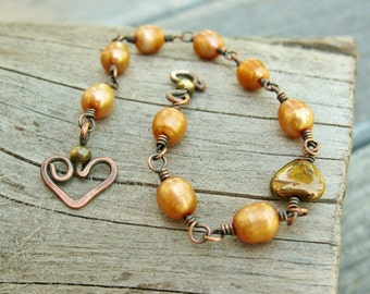 Freshwater Pearls Bracelet - wire wrapped pearl bracelet in Antiqued Copper with a bear hug heart